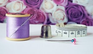 sewing pin thimble tape measure and sewing thread