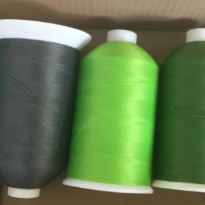 green sewing machine thread reels