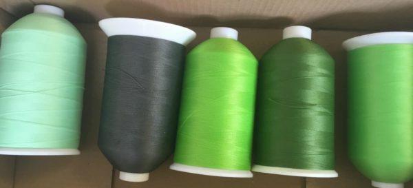 green sewing machine thread reels
