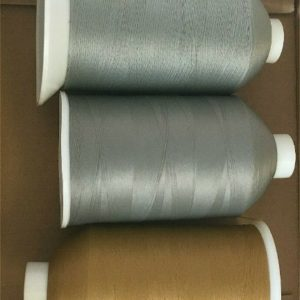 five reels of thread in grey beige and white