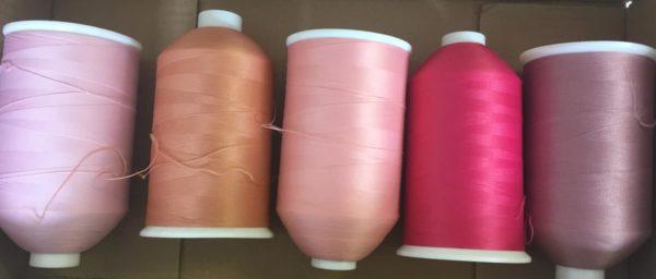 pink sewing machine thread reels