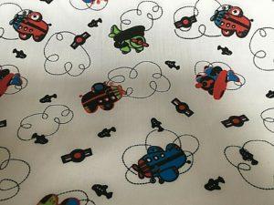 cream background aeroplanes fabric online