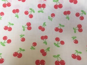 white background red cherries dress fabric