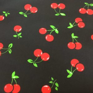 black background red cherries dress fabrics