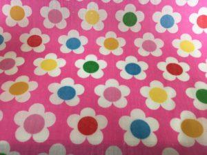 pink background muliti coloured flowers dress fabric
