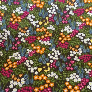 field of small flowers fabric orange oink blue and white