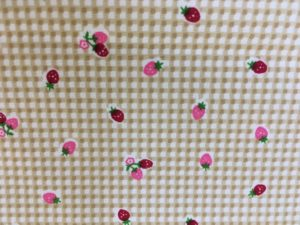 checked background pink and red strawberries fabric