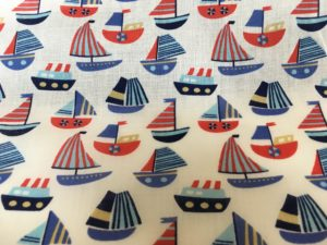 cream background blue sailing boats fabric online