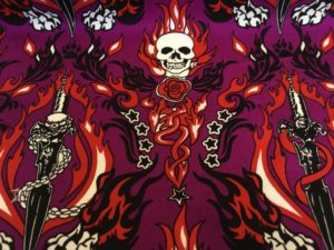 pink background skull and flames fabric online
