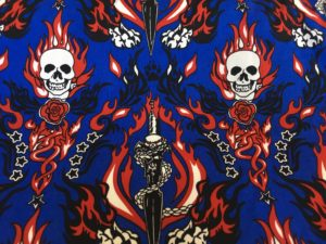 blue background skull and flames dress fabric