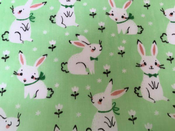 green background white rabbit dress fabric