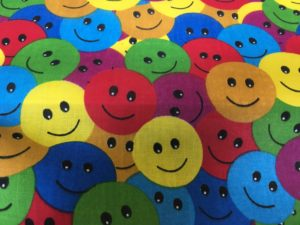 bright colours smiley face dress fabric