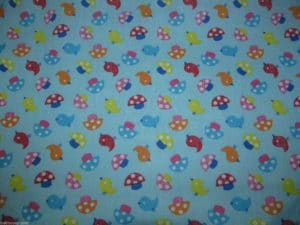light blue background mushrooms and birds fabric online