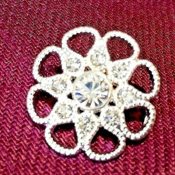 white dimante flower shaped button