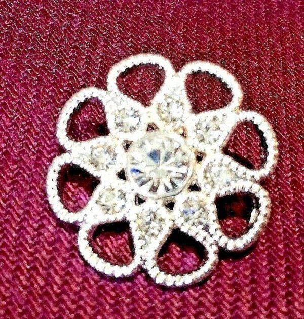 white dimante flower shaped button