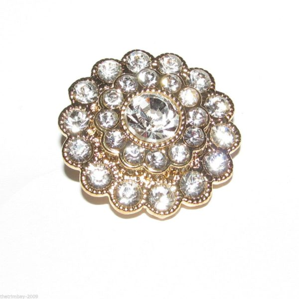 gold flower button with multiple white dimantes
