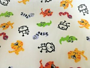 cream background snakes and alligator fabric online