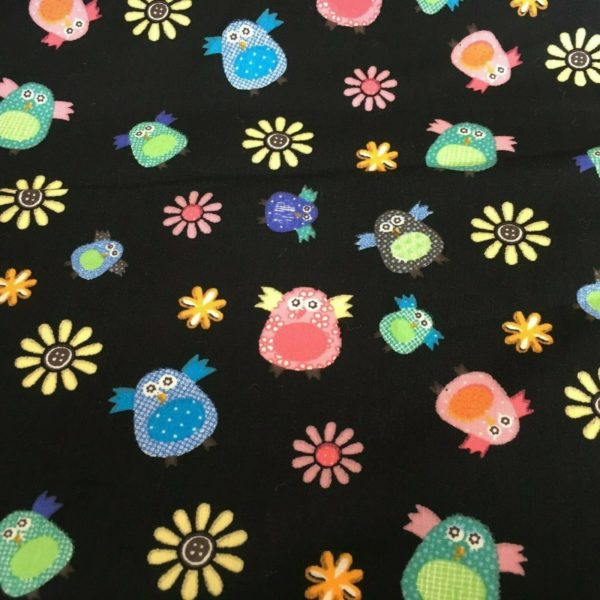 black background bright owls fabric online