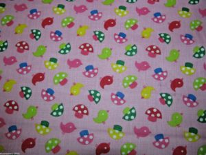 light pink background mushrooms and birds fabric online