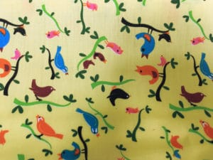 yellow background small multi coloured birds fabric