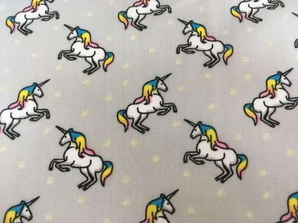 grey background, white unicorns with multicoloured hair fabric