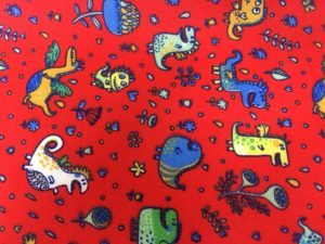 red background, child dinosaur and alien fabric