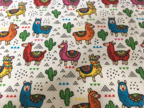bright multicoloured llama and cactus fabric