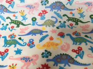 bright multicoloured dinosaur fabric