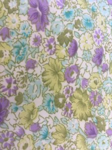 purple blue and green flowered fabric