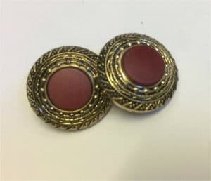 circle gold button with dark red smaller inserted circle