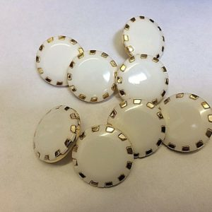 white round buttons with gold edges