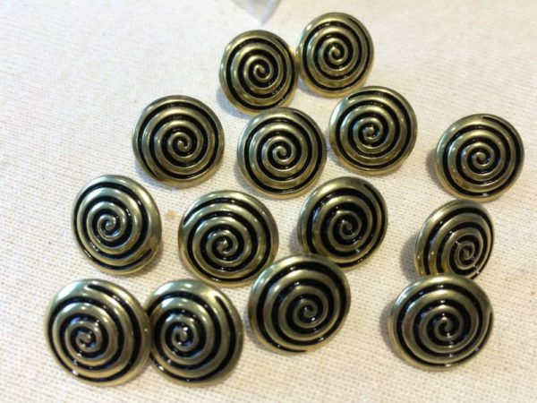 gold and black circle swirl buttons